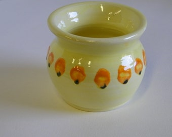 Little Yellow Pot with orange and black dots