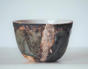 A small stoneware bowl with sgraffito design