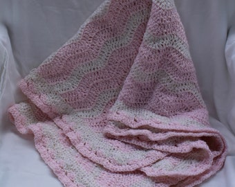 Handmade crocheted baby blanket or afghan.  Pink and White in colors.