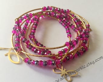Pink and Purple crystal beaded charm bracelet set with gold plated charms- Semanario pulseras color rosas y purpuras con dijes chapa de oro