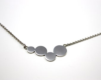 Hanging circles. Handmade in 925 Silver