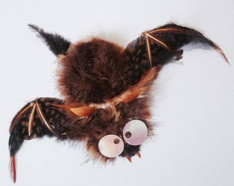 Feathers with cute bat sculpture painting