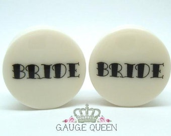 "Bride / Groom Plugs. 4g / 5mm, 2g / 6.5mm, 0g / 8mm, 00g / 10mm, 1/2"" / 12.5mm, 9/16"" / 14mm, 5/8"" / 16mm, 3/4"" /19mm, 7/8"" /22mm, 1"" /25mm"