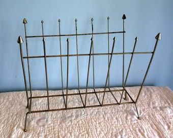Vintage Mid Century Brass Magazine Rack with Atomic styling Arrows at tops of brass ends