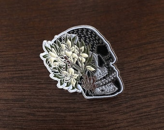 Azalea flowers on a Skull Enamel Pin