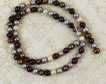Multi Colored Burgandy, Brown, Silver, Blue and Ivory Freshwater Pearls 16 inch strand