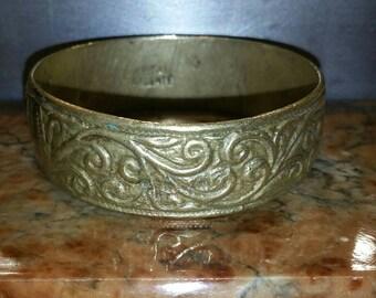 Ornate vintage brass bangle