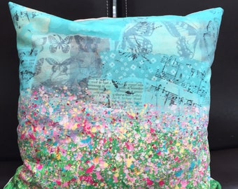 Splatter flower cushion