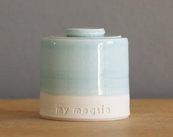 custom urn with lid. Handmade pottery pet urn or human ashes urn. White porcelain, light blue.