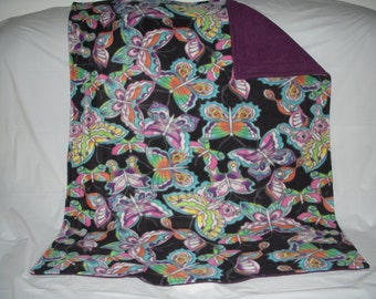 Pet Blanket - colorful butterflys on black print fleece with solid blackberry wine colored fleece on the reverse side.