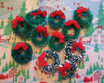 eleven tiny wreath decorations