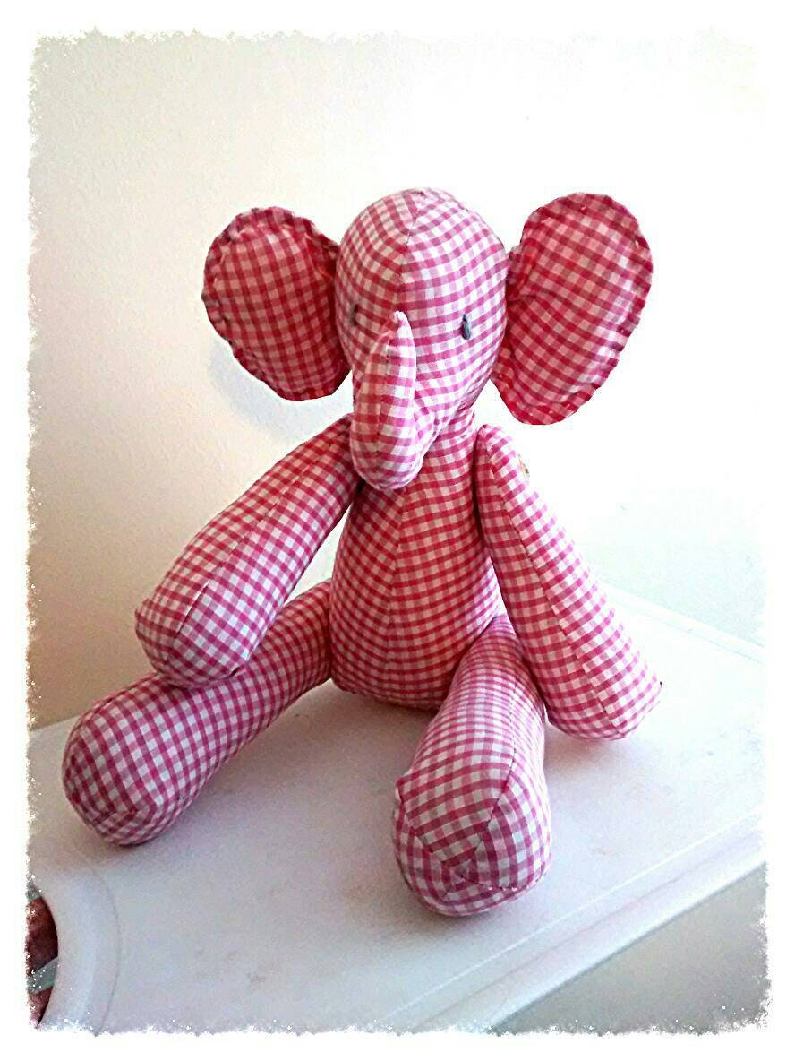 Elephant character in fabric kitsch. Button hinged limbs.