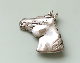 vintage  horse  Head Pin/ brooch in silver tone metal .