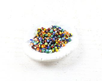 260 multicolor striped seed beads around 4 to 5mm LBP00715