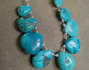 1 Strand Turquoise Arizona USA. natural layout beads. 27, grams. 12X14 , 20X22. MM