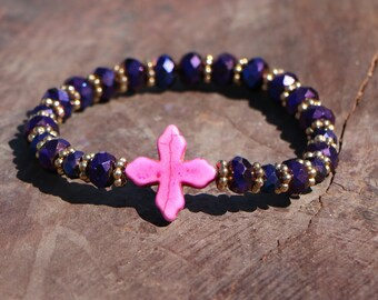 Majesty: Purple crystal beaded bracelet with hot pink ceramic cross and golden accents