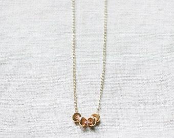 quartet - gold pendant necklace by elephantine