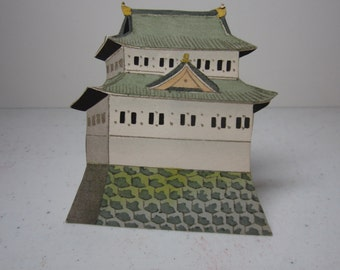 Vintage hand colored unused die cut 1930's place card of an asian building pagoda
