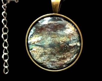 Abalone Shell and resin pendant.