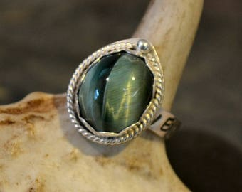 "Sterling silver ring with antique Green Tiger Eye stone.  Hand stamped band ""Never Say Never""  size 6.5"