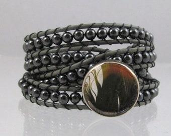 Wrap bracelet with Parrot feather button