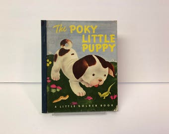 A Little Golden Book, The Poky Little Puppy by Janete Lowrey Published 1946 Eleventh Printing