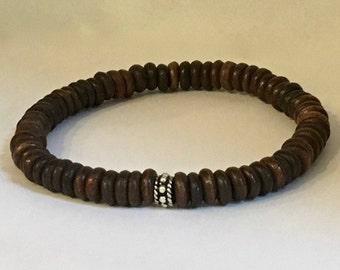 Men's warm brown ox bone bracelet with a bali sterling silver bead