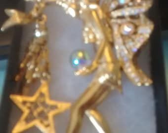 A fairy godmother brooch