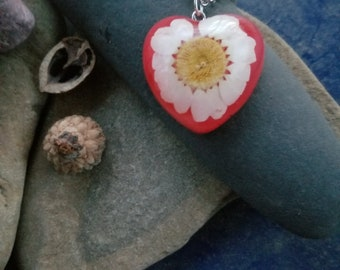 handmade red heart resin necklace with a real daisy flower