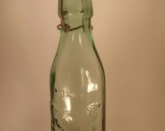 Recycled glass milk bottles made in Italy