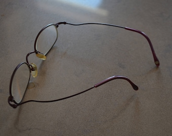 Free worldwide shipping!   Nine West 95' modern glasses!    Purple