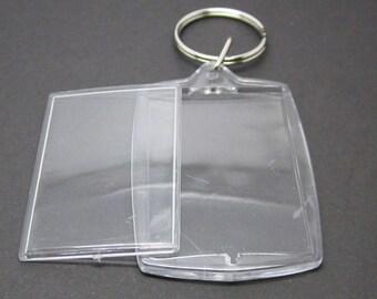 1 porte-clés en plastique transparent, rectangle arqué,pour photo de 3.2 * 4.6 cm.