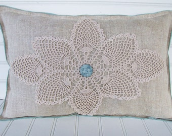 Vintage coastal pillow with doiley and hand painted button