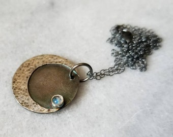 Sterling silver cratered crescent moon and tiny moonstone medallion necklace