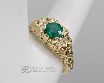 Emerald sculpted scroll ring