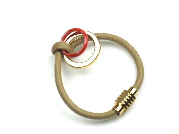 Cord Bracelet in Beige with Knotted Mokuba Cord and Gold and Red-Orange Accent Rings