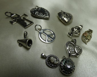 11 Sterling Silver charms/necklace or bracelet- 22 grms total - all hallmarked 2746