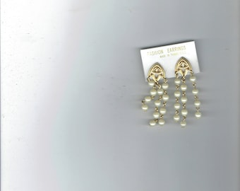 fashion earrings with 3 strands of faux pearls dangling 1980's