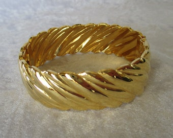Bracelet/Vintage wide bold gold clamp bangle bracelet swirl design 80's retro heavy