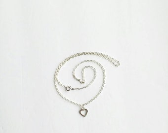 Sterling silver earrings and necklace with a heart pendant.