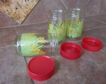 Mid Century Anchor Hocking Storage Jars, Set of 3, Red Plastic Screw on Cap, Pretty Flowers and Leaves, Excellent Condition, Nice Find
