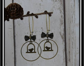 Birds in antique bronze circle earrings