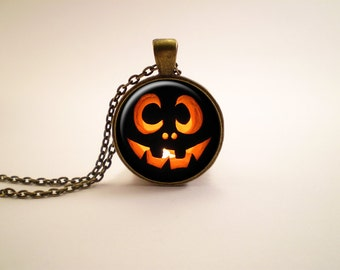 Halloween pumpkin glass pendant, antique bronze tone setting