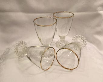 Set of 4 vintage glasses with gold trim