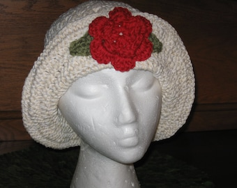 hand crocheted hat with red flower