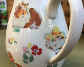 Gorgeous guinea pig jug absolutely stunning with its Cath flowers, from the pets party range , unique gift, housewarming, thank you gift