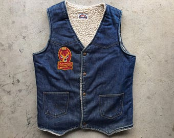 Vintage Wrangler Shearling denim vest. Patches and hand-painted back.