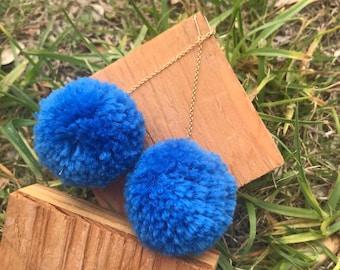 16k gold dangle earring with blue Pom pom