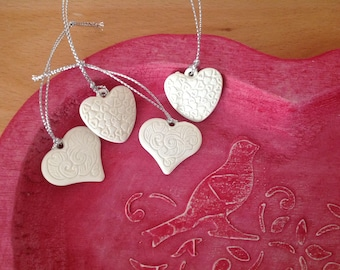 White set of 4 hearts hanging