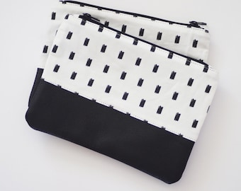Printed canvas and cowhide leather zippered pouch clutch
